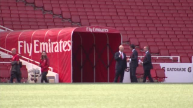 photocall ENGLAND London Emirates Stadium EXT Unai Emery sitting in the stands / Emery photocall and handshake with Ivan Gazidis / Emery posing with...