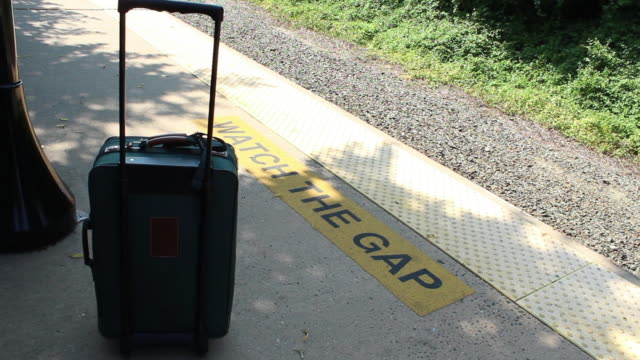 unattended baggage at the east hampton station - long island railroad stock videos and b-roll footage