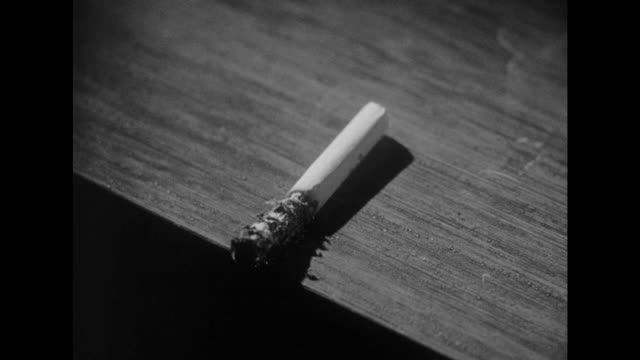 1948 unattended cigarette burns tabletop - film noir style stock videos and b-roll footage