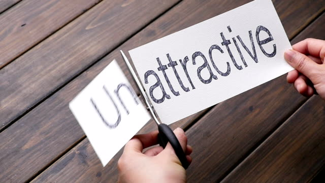 unattractive to attractive by scissors on pattern wood plank - ugliness stock videos and b-roll footage