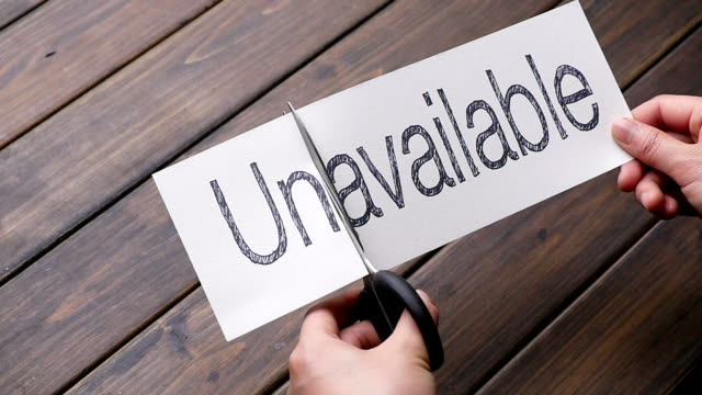 unavailable to avalable by scissors on pattern wood plank - scissors stock videos and b-roll footage