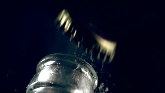 uncapping the bottle. super slow motion - cap stock videos & royalty-free footage