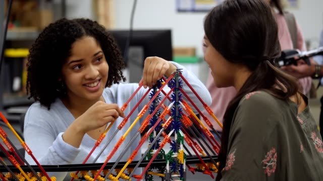 uncertain female high school student builds bridge in engineering class - bridge built structure stock videos & royalty-free footage