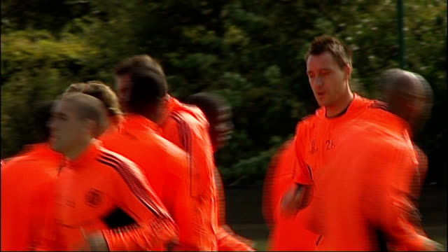 uncertainty over key arsenal and chelsea players surrey cobham chelsea and england captain john terry dogged by allegations of racism training with... - cobham surrey stock videos and b-roll footage