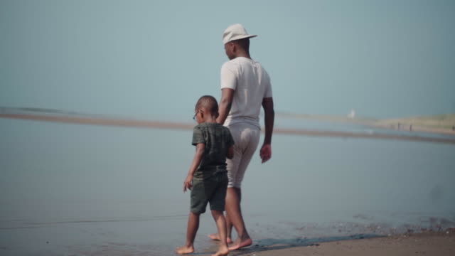 uncle and nephew walking into the water