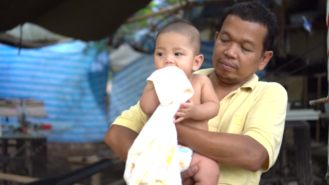 uncle carrying a cute little baby. - modern manhood stock videos & royalty-free footage