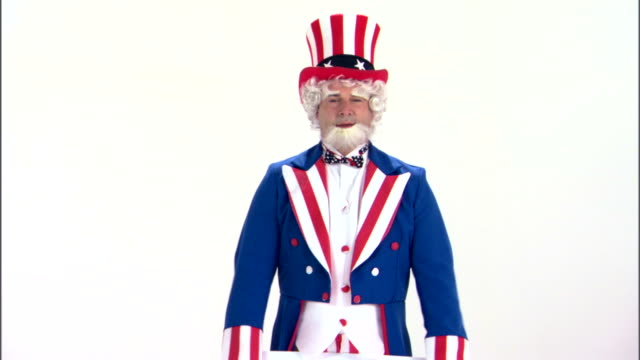 uncle sam holding call now sign - uncle sam stock videos & royalty-free footage