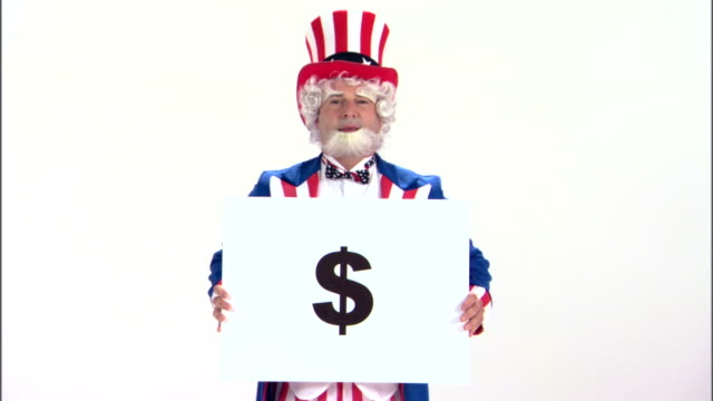 uncle sam holding money sign - uncle sam stock videos & royalty-free footage