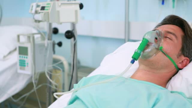 Unconscious patients with oxygen masks