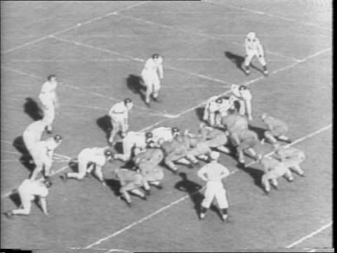 vídeos de stock e filmes b-roll de undefeated ohio state buckeyes football beats northwestern wildcats father's day 1942 / people on field form letter 'n' / ohio state running onto... - 1942