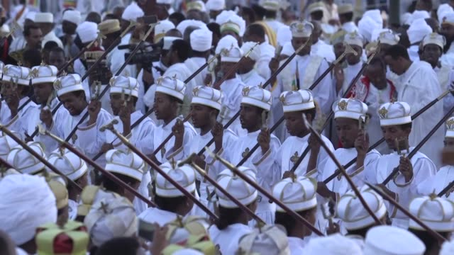 Under a blazing sun a procession carrying a replica of the Ark of the Covenant marched on a path of red carpets through the streets of Ethiopia's...