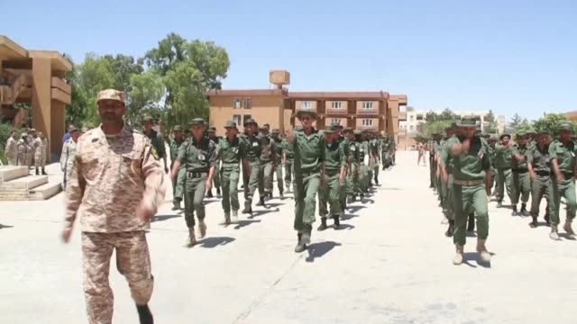 Under a blazing sun at a military centre in western Libya dozens of young recruits learn to march in formation as authorities train the country's...