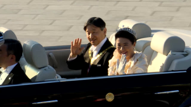 under blue skies and perfect fall weather a beaming emperor naruhito and empress masako waved to the large crowds of wellwishers along their parade... - blue convertible stock videos & royalty-free footage