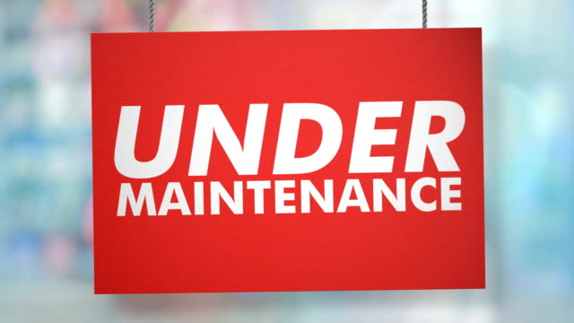 under maintenance sign hanging from ropes. luma matte included so you can put your own background. - banner sign stock videos and b-roll footage