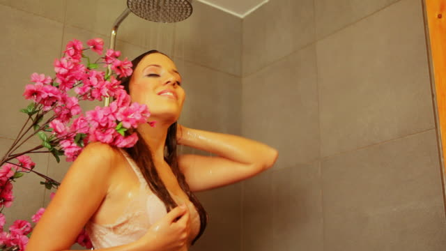 hd: under shower - wet hair stock videos and b-roll footage