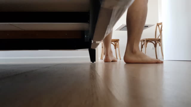 under the bed on man feet putting on slippers - hardwood floor stock videos & royalty-free footage