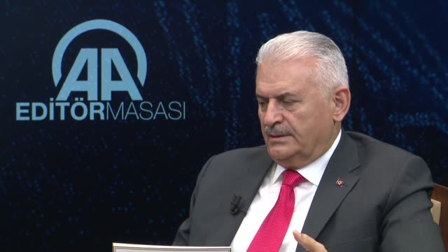 under turkey's new system, the parliament will wield more influence, said prime minister binali yildirim on thursday. speaking as the special guest... - 説得点の映像素材/bロール