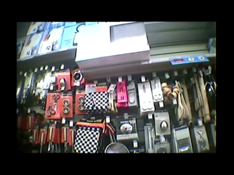 Undercover filming interior pov shots anon underage shopper browsing knives in hardware store interiors anon shopper attempts to purchase knife in...