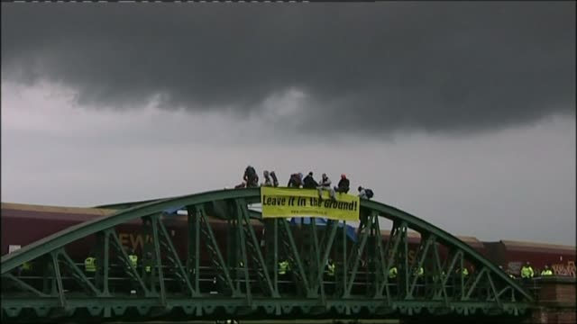Undercover policing inquiry T13060812 / TX Environmental protestors seated on railway bridge banner reads 'Leave It In The Ground' Protestors...