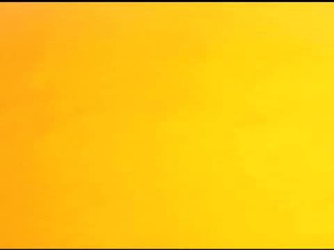 undercranked tilt down to a heart of glitter. - softfokus bildbanksvideor och videomaterial från bakom kulisserna