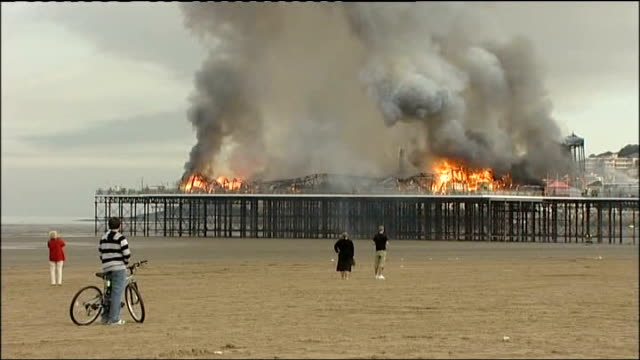 underfunding leading to loss of many of britain's historic seaside piers t28070814 westonsupermare pier engulfed in flames as few local people watch... - pavilion stock videos & royalty-free footage