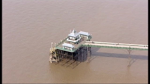 underfunding leading to loss of many of britain's historic seaside piers; r23080807 somerset: clevedon pier: air view / aerial of clevedon pier - clevedon pier stock videos & royalty-free footage