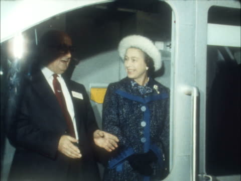 Underground link to Heathrow Airport opened by the Queen ENGLAND PreComm S Queen in driver's cab of tube EKT 16mm ITN 10secs 6ft
