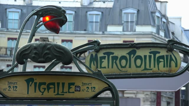 underground metro station pigalle, paris, france, europe - stazione della metropolitana video stock e b–roll
