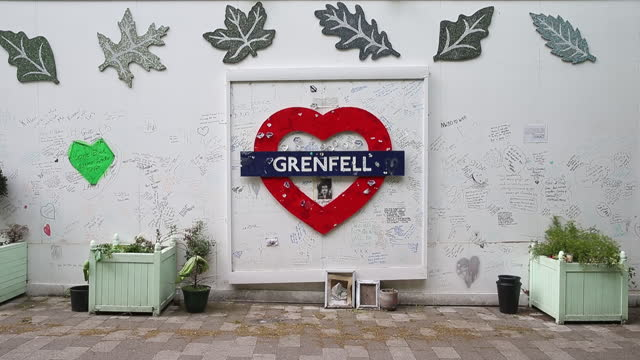 underground sign commemorating those who died in grenfell fire in notting hill district of london, u.k., on wednesday, may 12, 2021. - incidental people stock videos & royalty-free footage