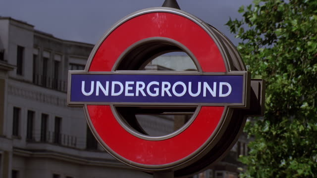 cu underground sign on road / london, uk - western script stock videos & royalty-free footage