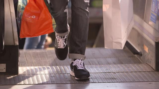 vídeos y material grabado en eventos de stock de underground station, escalator, legs  - human foot