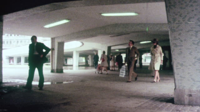 1976 MONTAGE Underground systems are built for pedestrian traffic in the city / Birmingham, England, United Kingdom