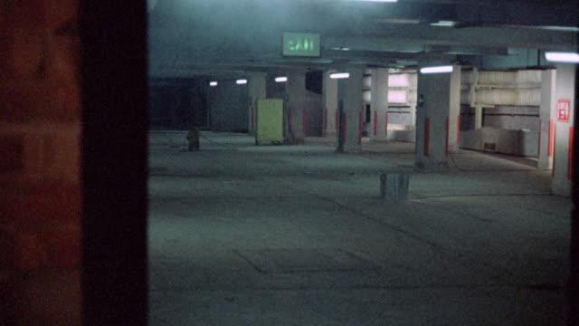 1973 MONTAGE Underground tunnel leading to parking garage / Nottingham, England, United Kingdom