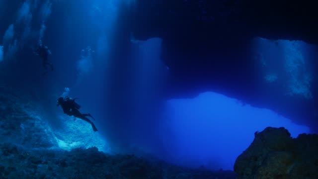 undersea cavern, blue hole, palau - cave stock videos & royalty-free footage