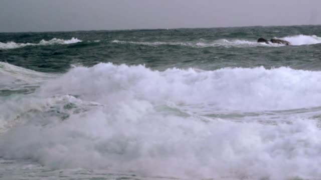 undersea internet connections are potentionally vulnerable to attack; t20111411 / tx england: cornwall: waves crashing portcuno: high angle view... - undersea video stock e b–roll