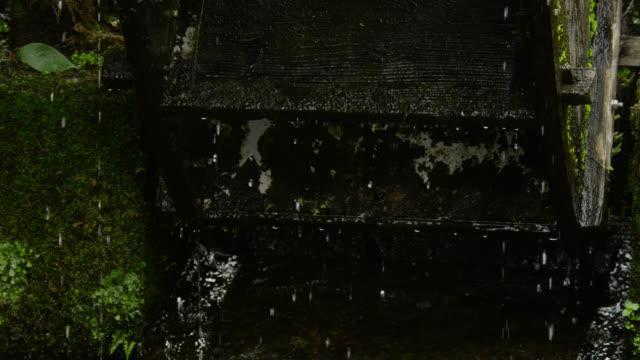 undershot waterwheel turning, japan. - insel honshu stock-videos und b-roll-filmmaterial