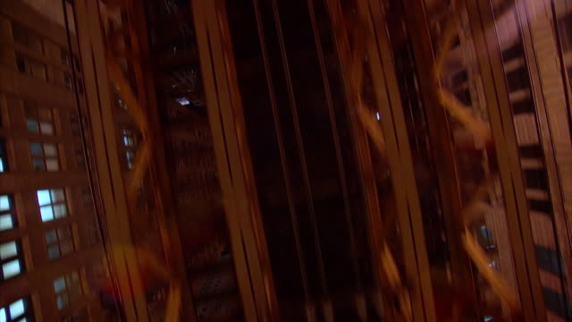 ms pov underside of l train elevated tracks at night / chicago, illinois, united states - chicago 'l' stock videos & royalty-free footage
