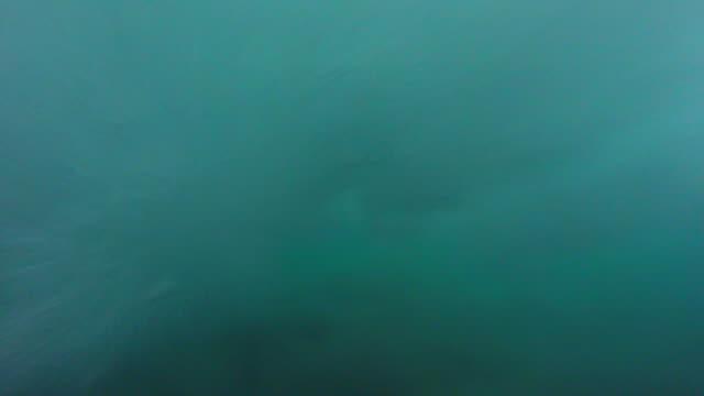underwater pov of a man sup stand-up paddleboard surfing. - slow motion - underwater stock videos & royalty-free footage
