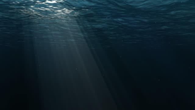 underwater blue background in sea with sun in ocean - underwater stock videos & royalty-free footage