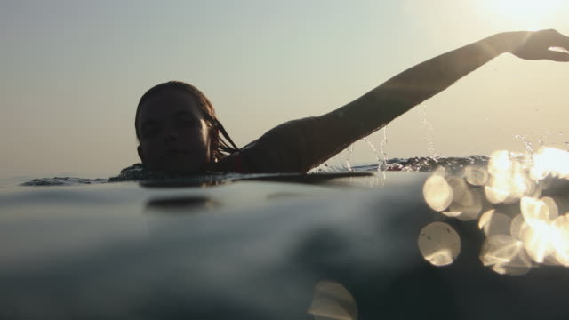 underwater camera shot of woman swimming in open sea during summer vacation - underwater camera stock videos & royalty-free footage
