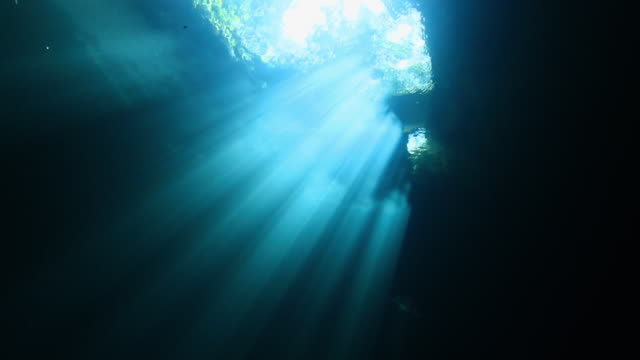 """Underwater cave lit with sunlight, blue and green light, Gulf of Mexico"""