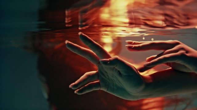 underwater dance. delicate touch - toccare video stock e b–roll