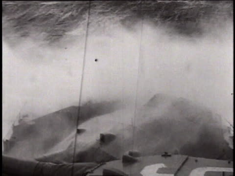 stockvideo's en b-roll-footage met underwater explosions / waves crashing on the deck of the bismarck / fairey swordfish dropping a torpedo / bomb exploding near the bismarck - bom