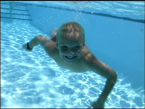 underwater extreme close-up of a little boy swimming toward the viewer, smiling. - see other clips from this shoot 1135 stock videos & royalty-free footage