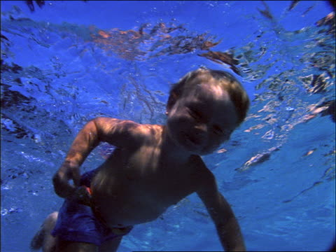 underwater low angle of baby swimming in swimming pool - one baby boy only stock videos & royalty-free footage