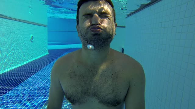 underwater man portrait in swimming pool. - full stock videos & royalty-free footage