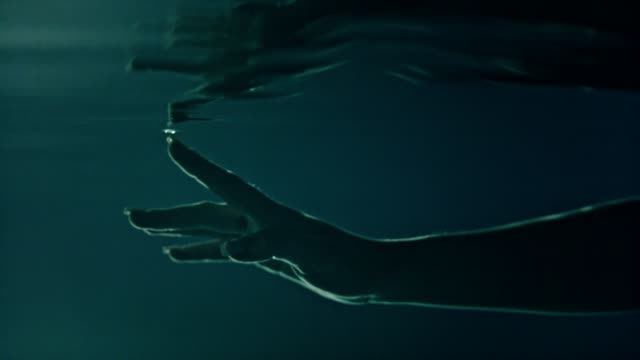 underwater meditation. reaching hand reflections - dark stock videos & royalty-free footage
