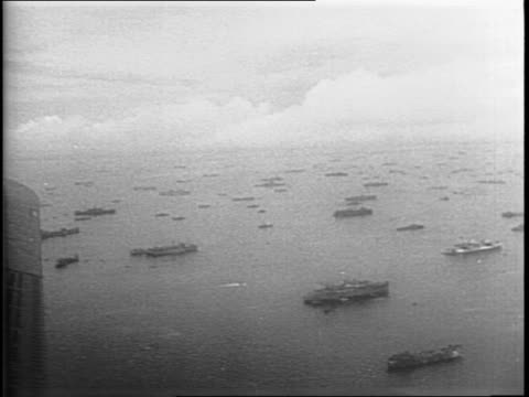 underwater mines are dropped off an american battleship / map of japan and an animation of mines chains and ships surrounding japan / hundreds of... - william halsey stock-videos und b-roll-filmmaterial