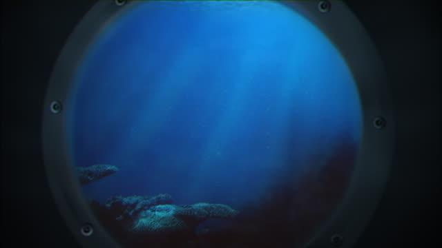 vidéos et rushes de sous l'eau de l'océan à travers des hublots - hublot