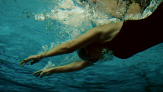 underwater shot of a female swimmer - swimming goggles stock videos & royalty-free footage